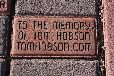 Tom's brick of dedication at the Fur Peace Ranch